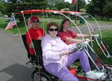 Biking together Quadribent recumbent bikes for two with rumble seat and sunroof canopies