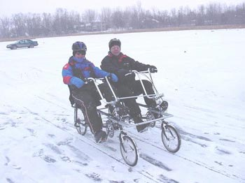 Carl and Jon riding the Quadribent in the World Championship HPV Ice Races on a frozen Minnesota lake.