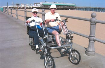 Biking with their Quadribent on the boardwalk in Virginia Beach, Virginia.